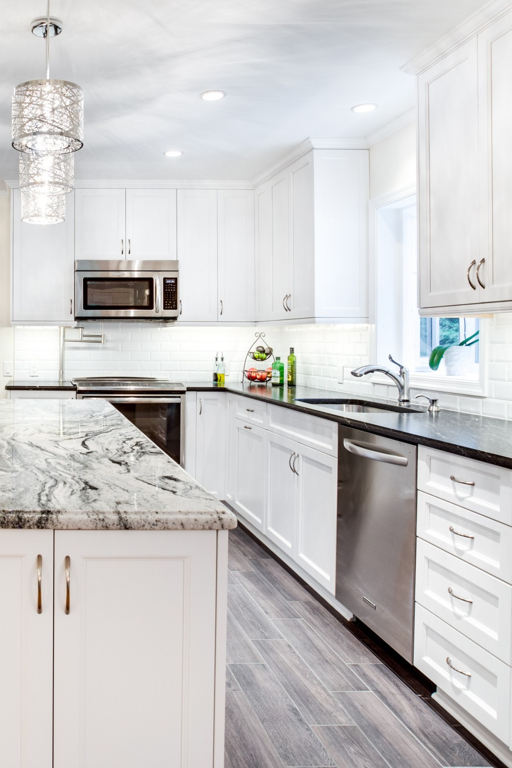 a white Shaker island and cabinets