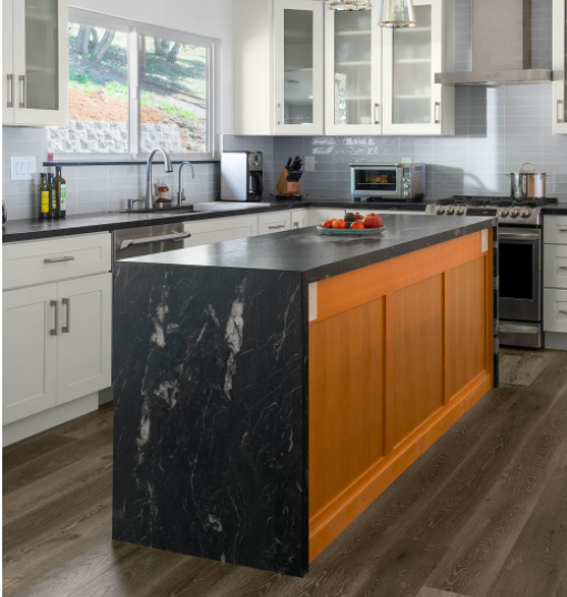 White Shaker cabinets with black waterfall countertops