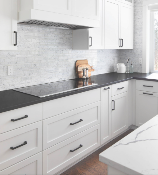 Perfect blend of white cabinets with countertops in both black and white kitchen in this contemporary kitchen