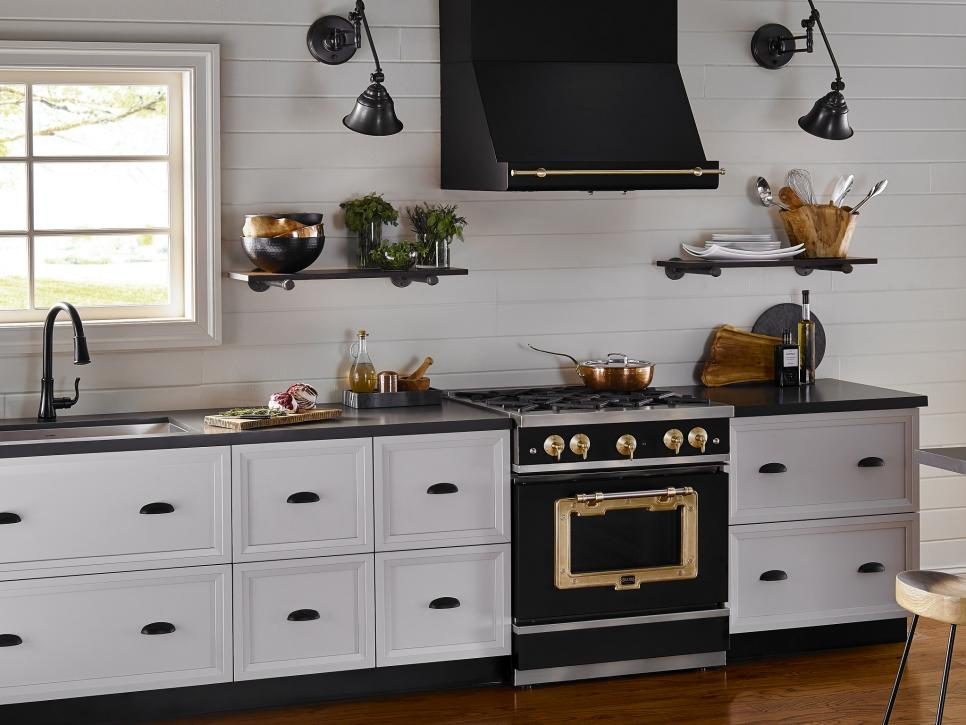 White cabinets and black countertop with pops of color